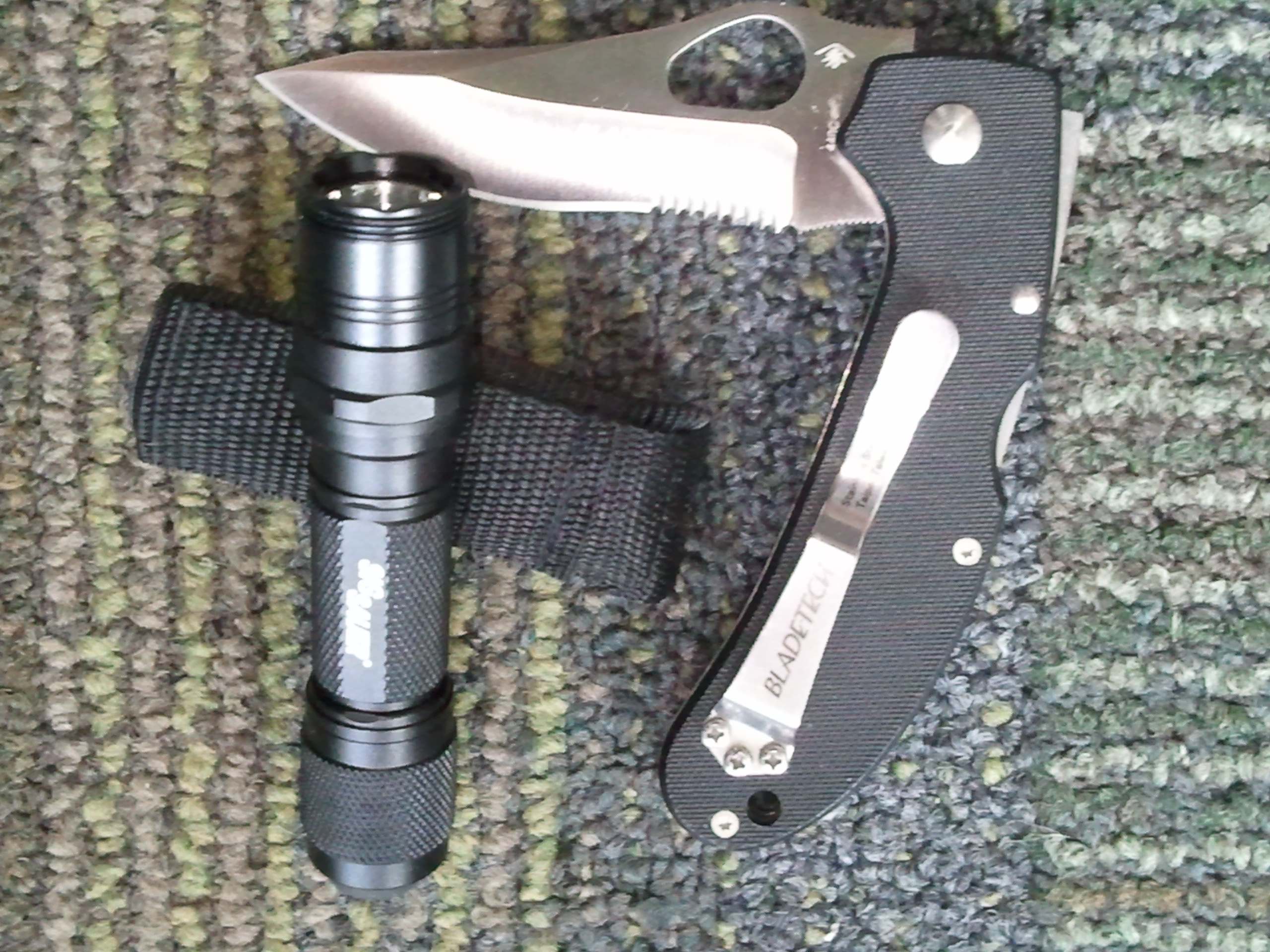 Small flashlight and pocket knife for survival kit