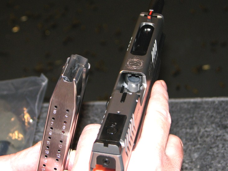 High capacity magazine w/ 19 rounds of 9mm & ruby like front sight