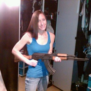My wife with our WASR still in stock form.